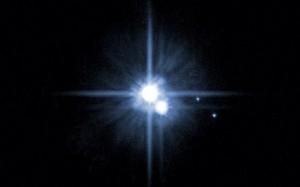 Plutão e três das suas luas